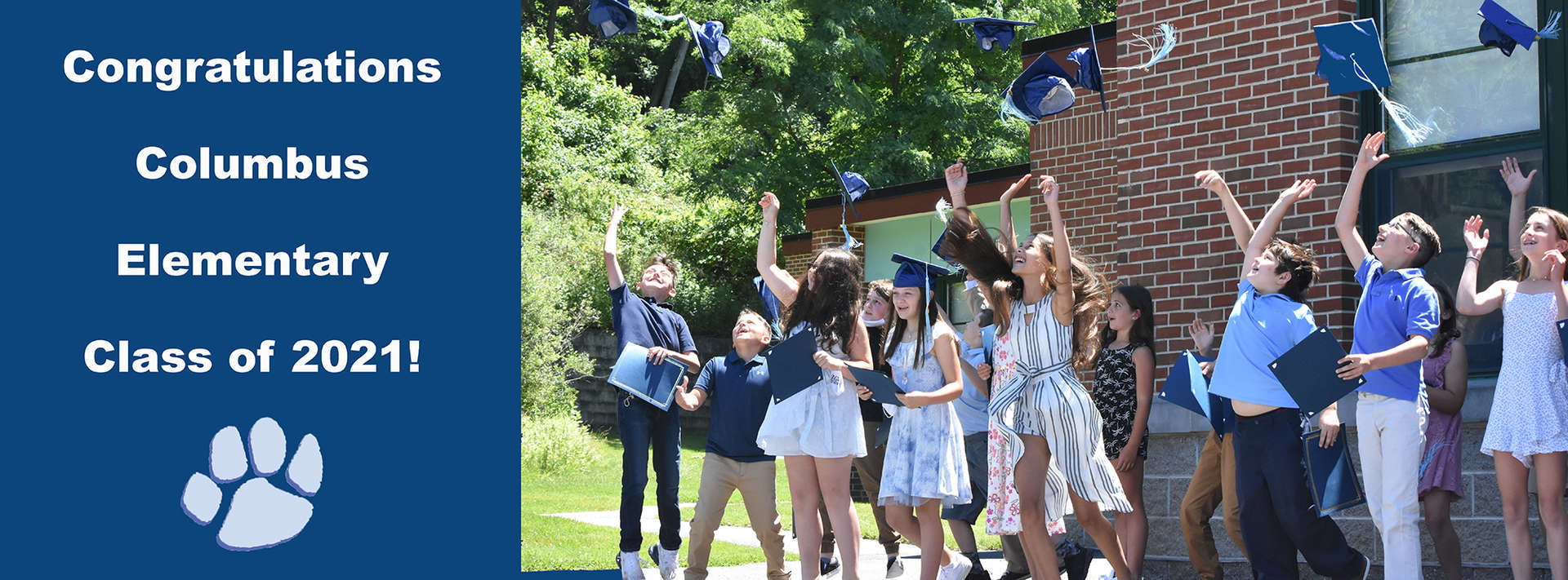 Group of kids throw graduation caps in the air