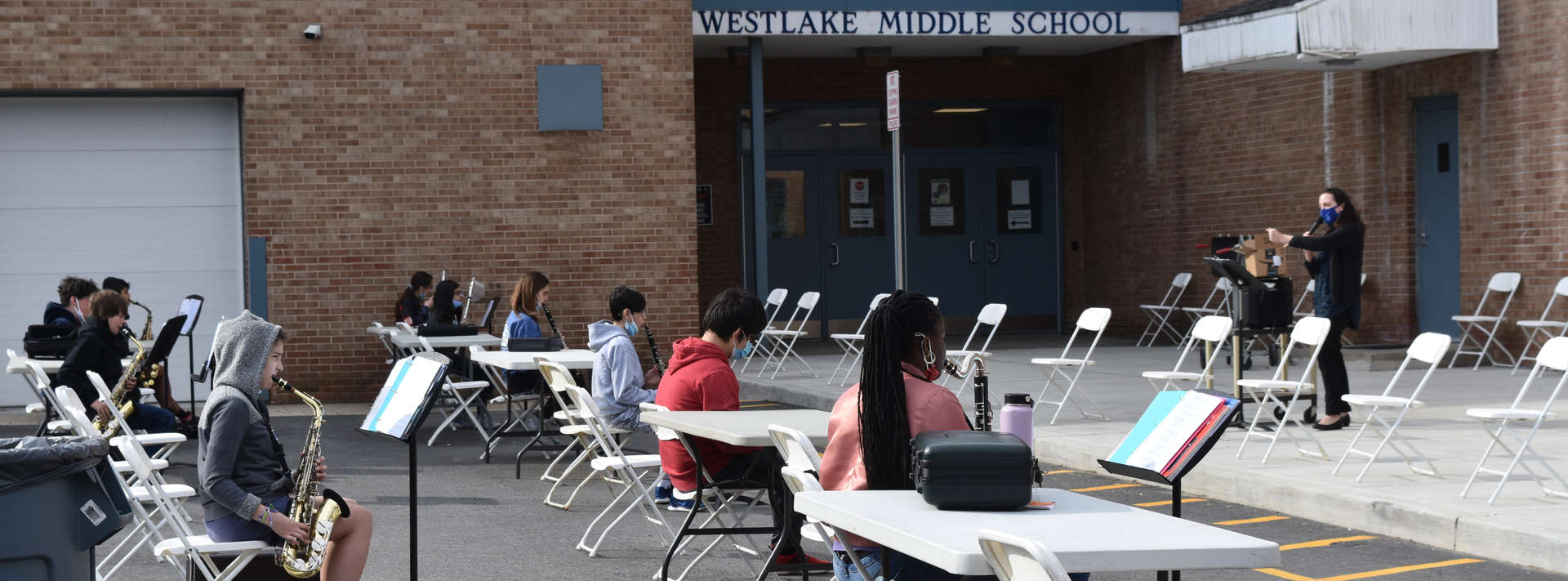 Band students practice their instruments outdoors