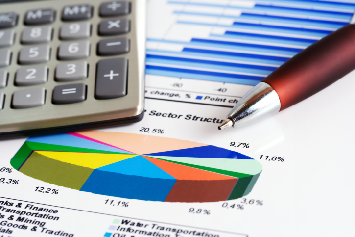 Financial reports with calculator and pen