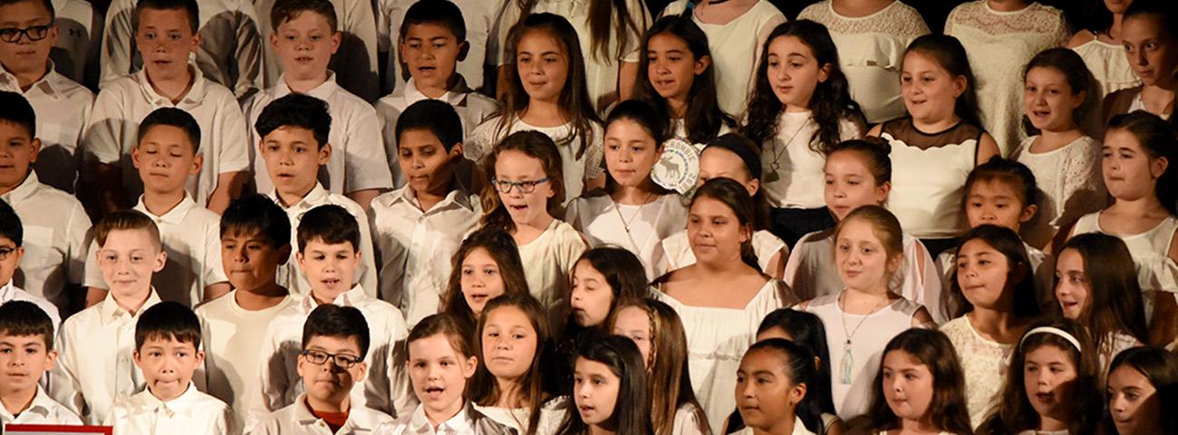 Children singing in the chorus