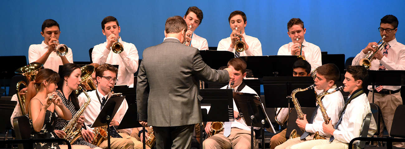 Conductor directs band students