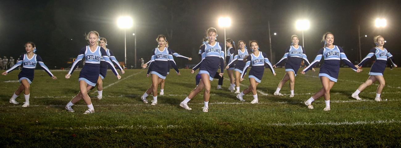Cheerleaders performing on field