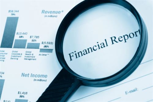 Magnifying Glass looking at financial reports
