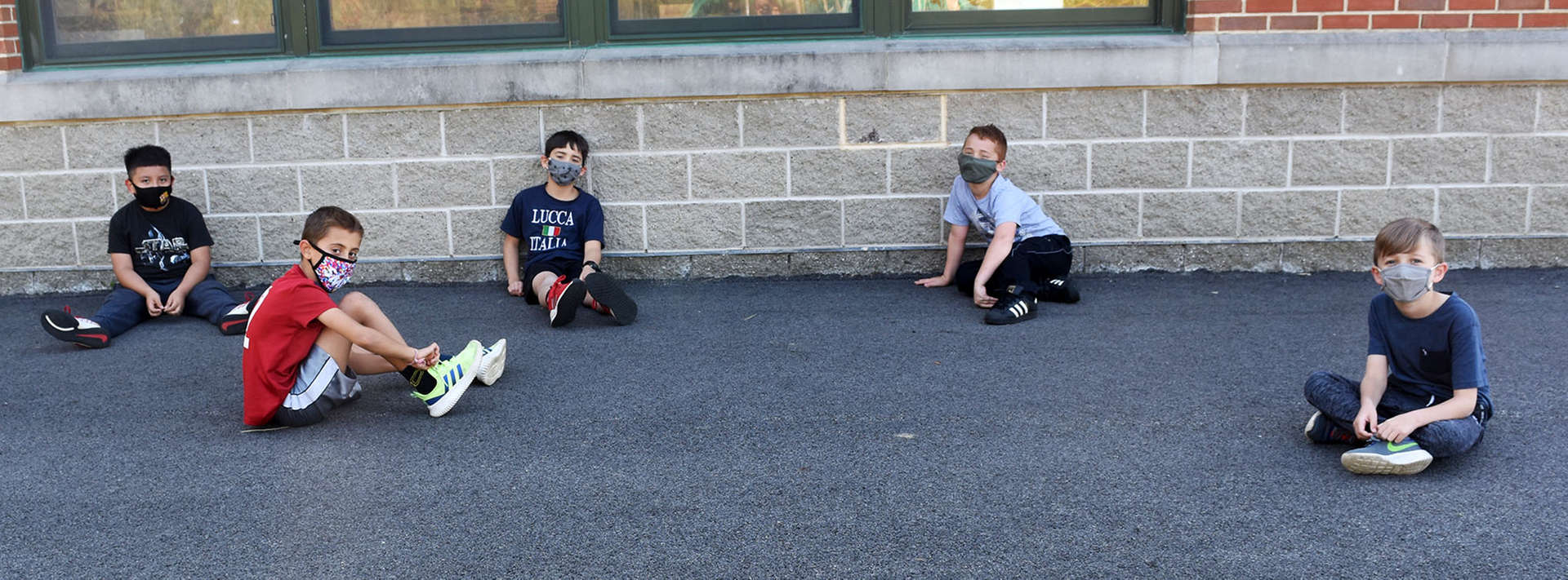 boys sit separate from each other at recess