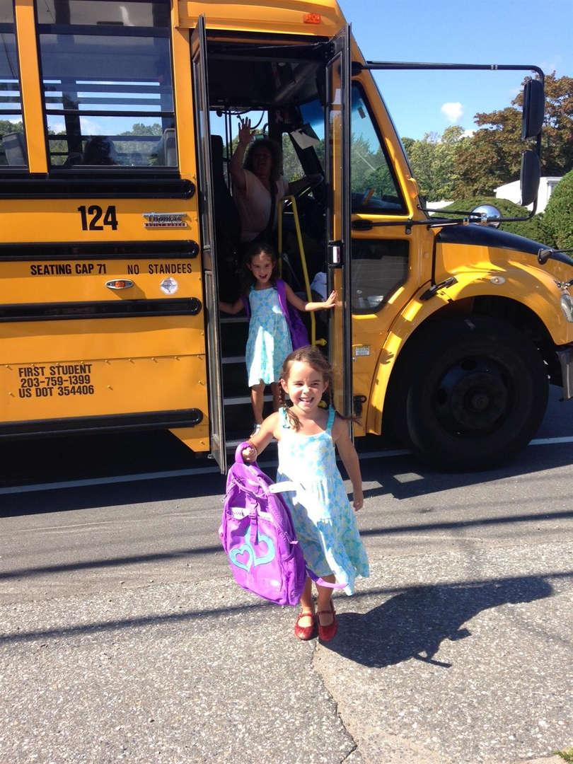Student getting off schoolbus