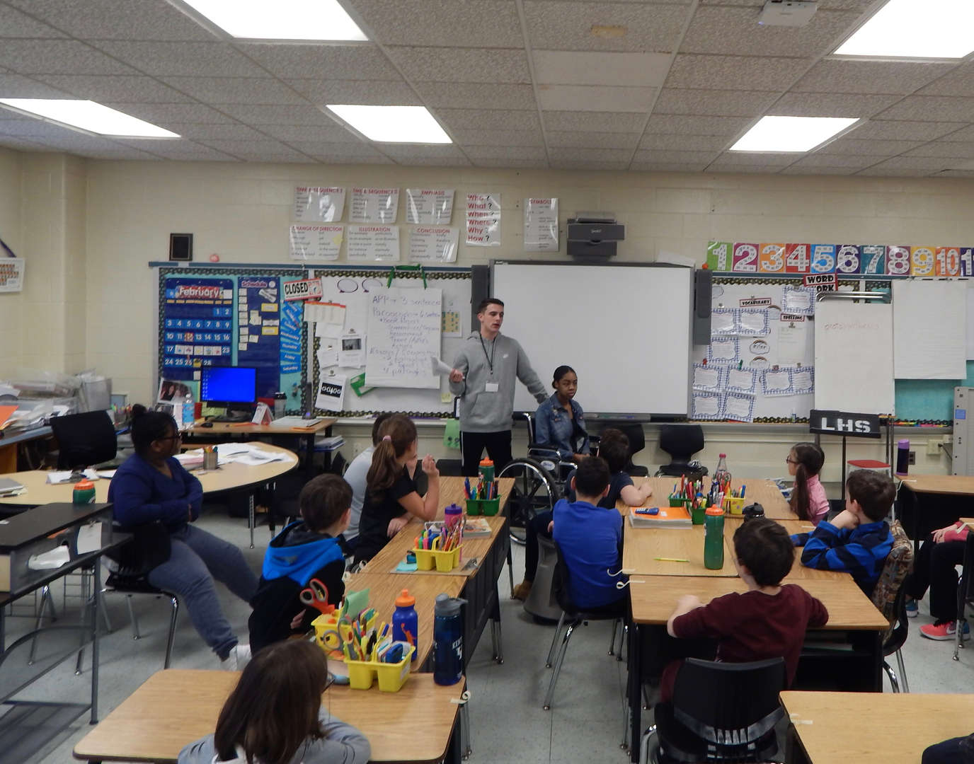 High School students speaking to younger students.