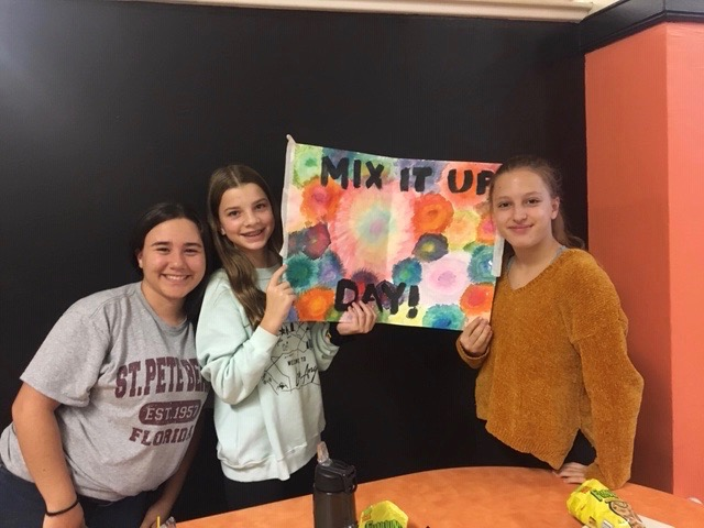 students posing with Mix It Up sign