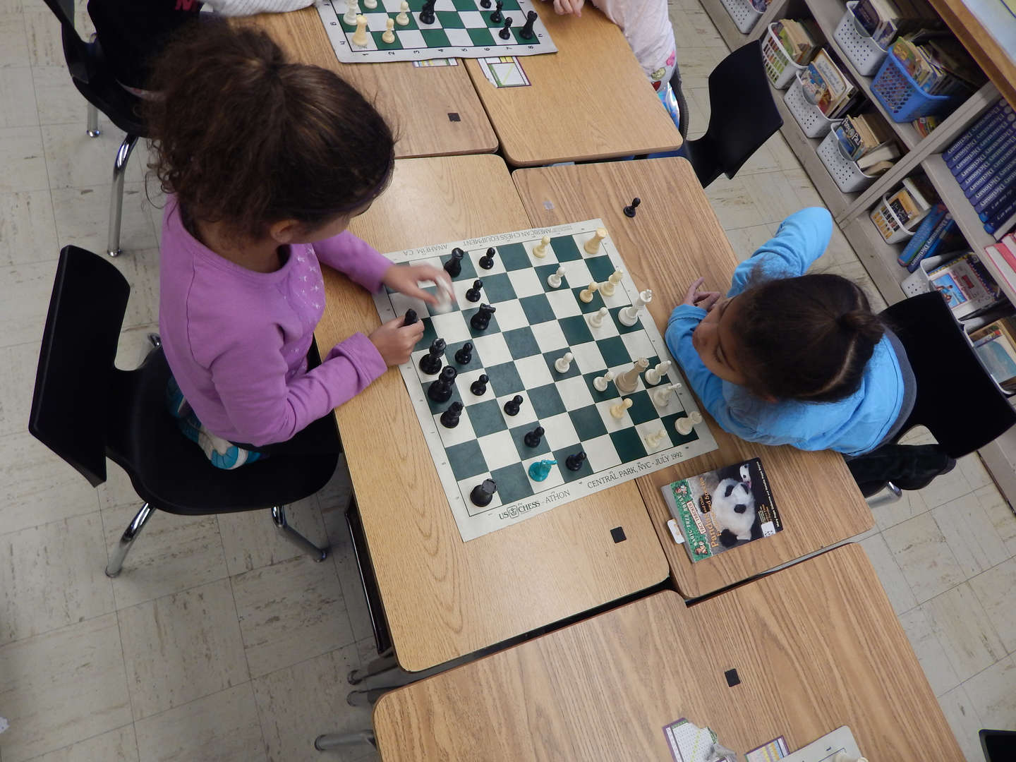 2 children playing chess