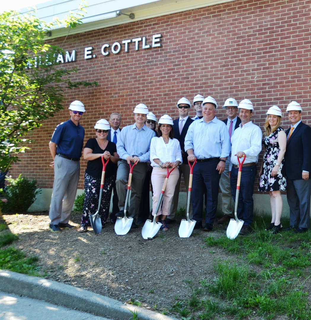 board members and administrators posing with shovels