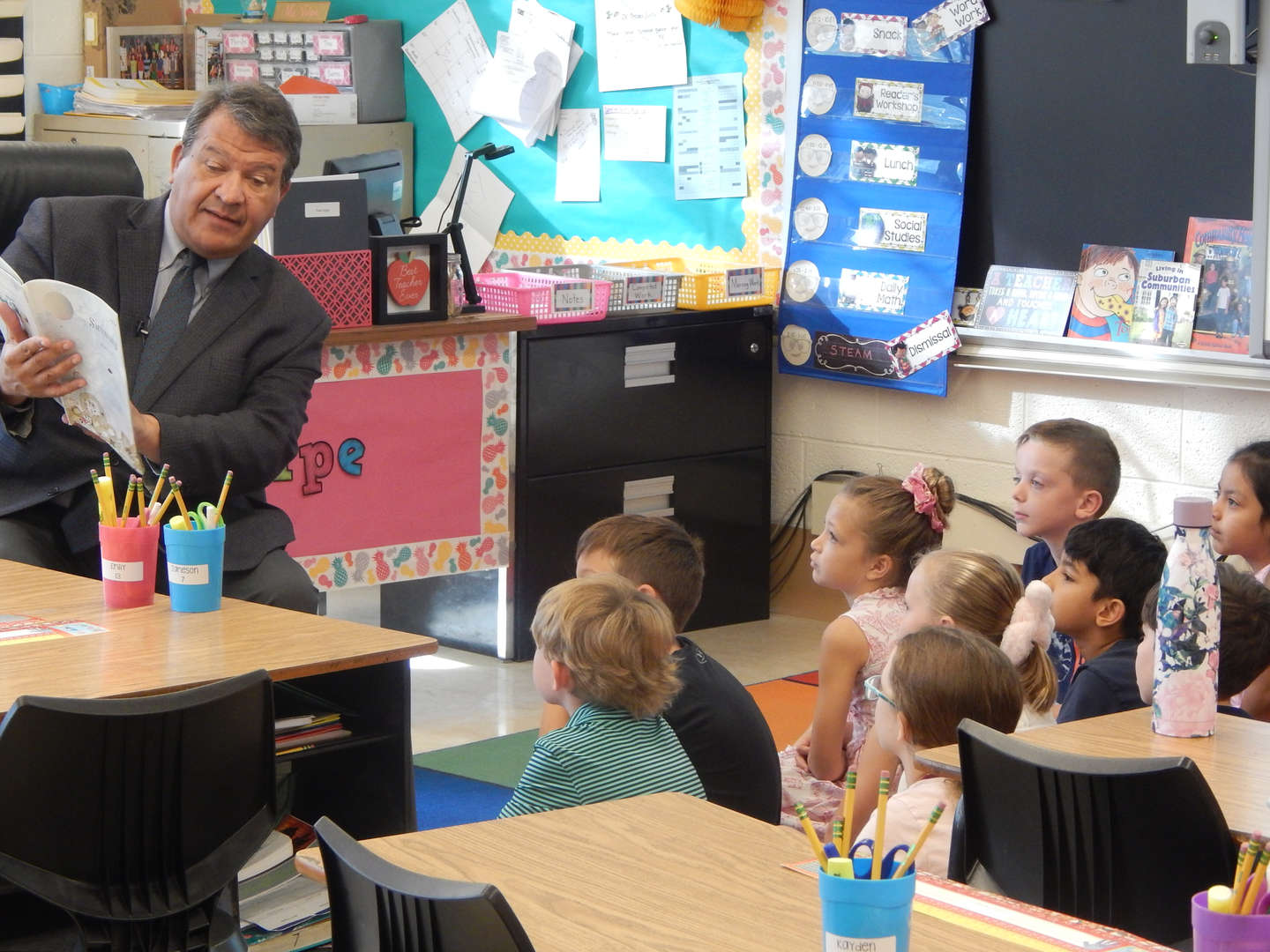 George Latimer reads to a second grade class