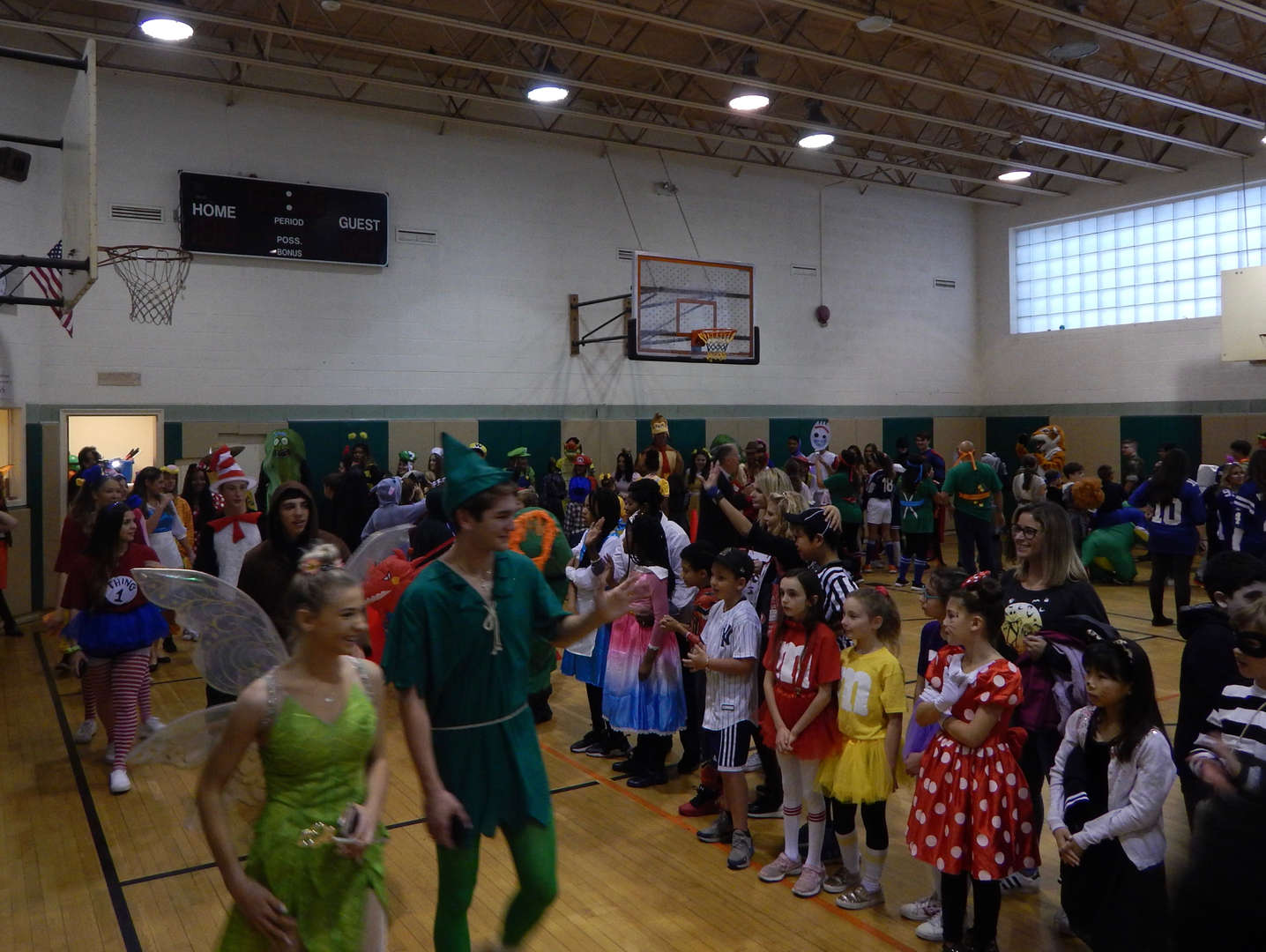 students in costumes marching and watching parade