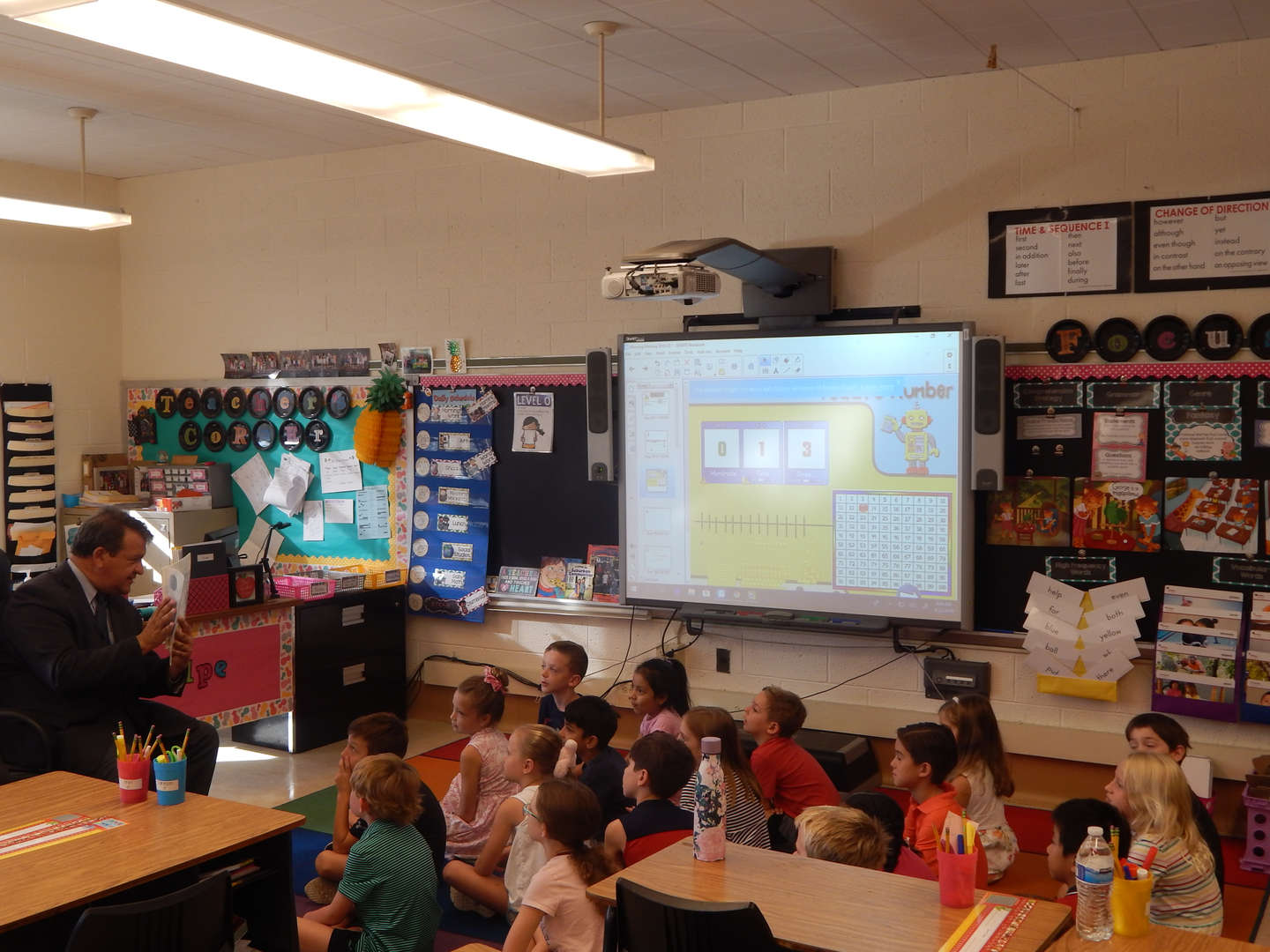 George Latimer reads to a second grade class.