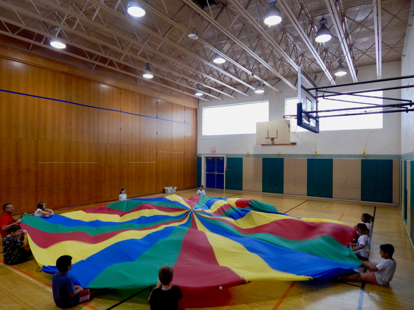 students playing with a parachute