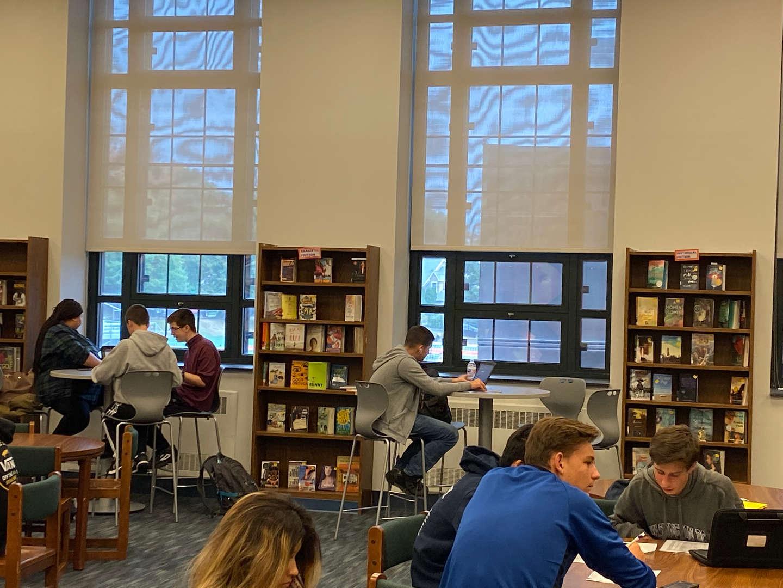 students talking at tables