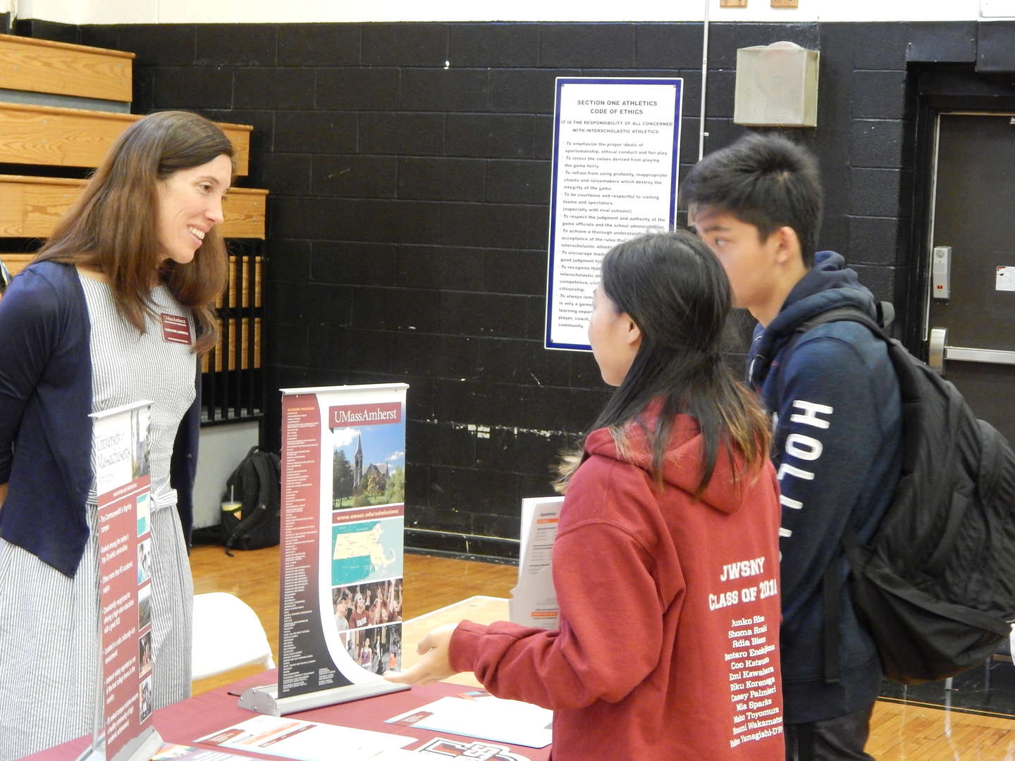 students speaking to college representative