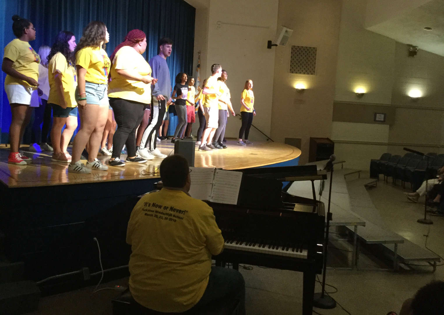 Students entertain local senior citizens with performing arts presentations.