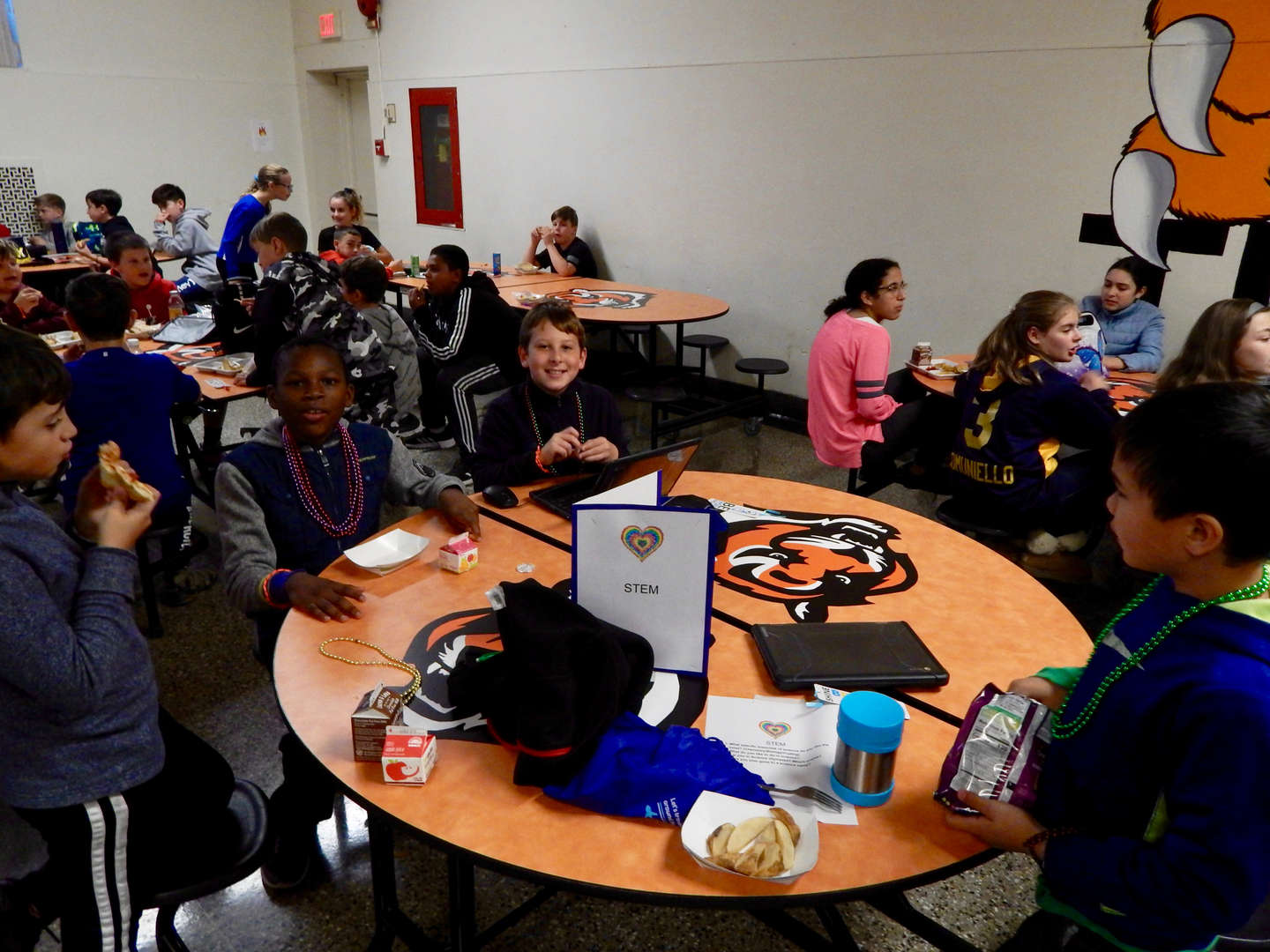 students sitting at a table eating lunch