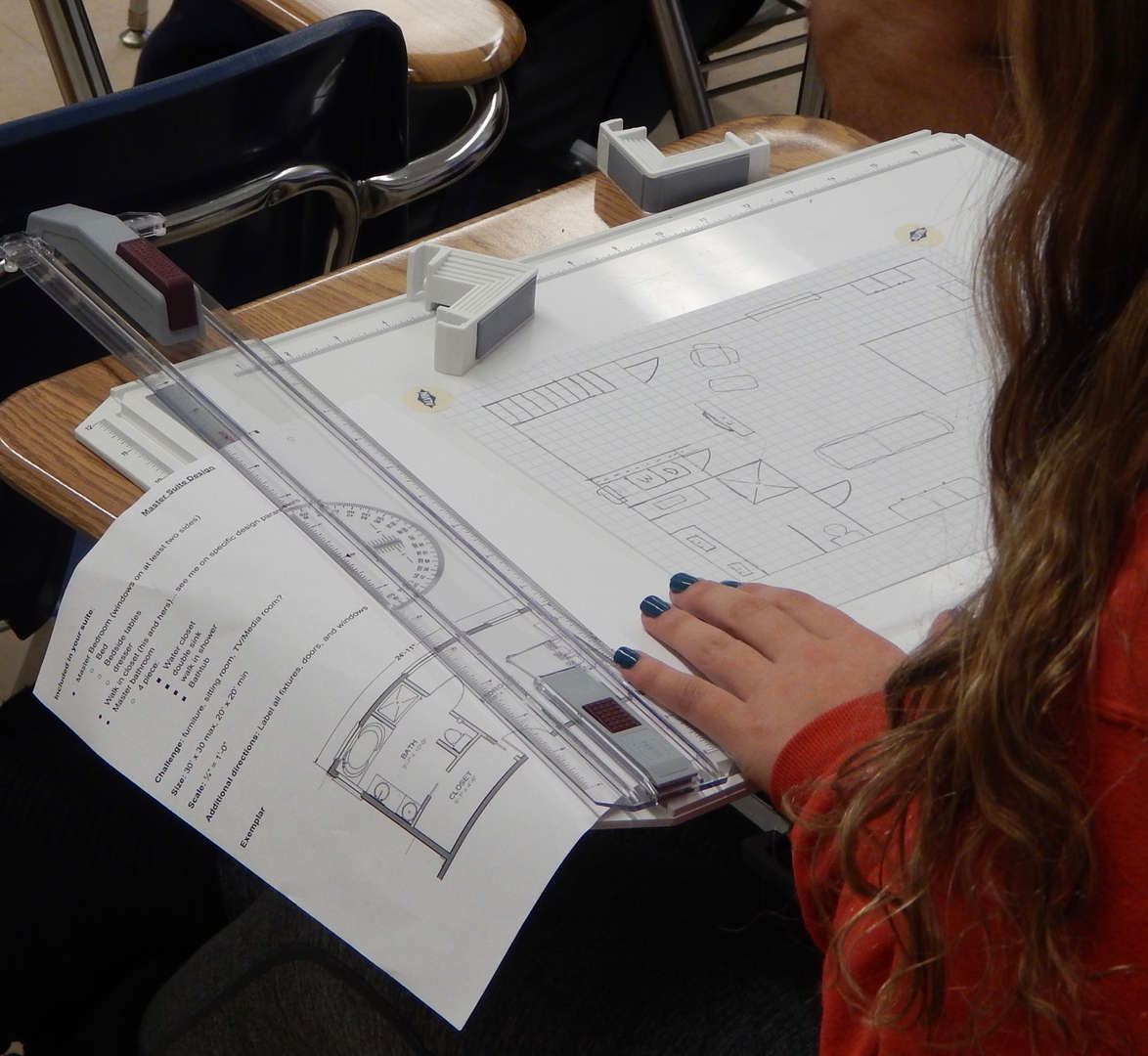 student drawing architecture plans