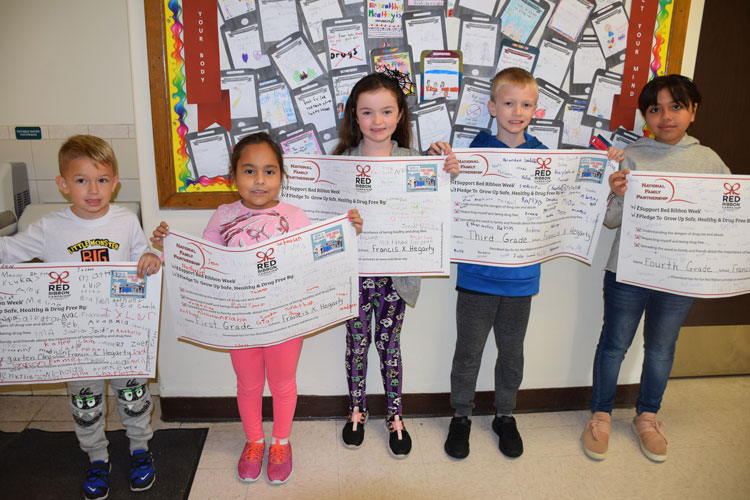 Hegarty students from each grade signed Red Ribbon Week pledges to stay drug free.