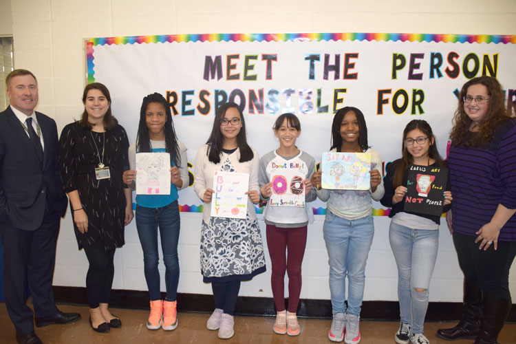 Lincoln Orens Middle School's anti-bullying poster contest winners, pictured with Principal Dr. Bruce Hoffman and Student Council Advisers Marissa Mendes and Ilyse Prince, display their meaningful work.