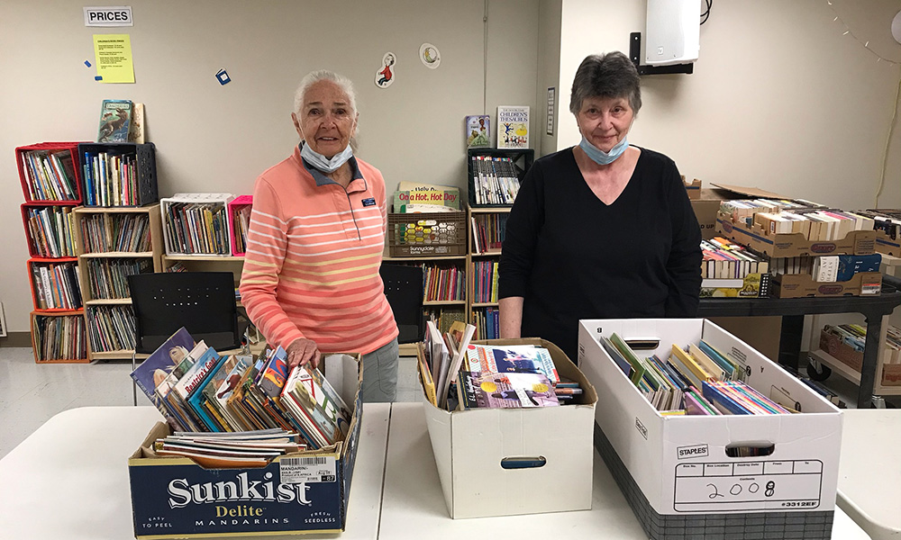 Volunteers from Friend of Kent Library pack books for Kent Elementary students