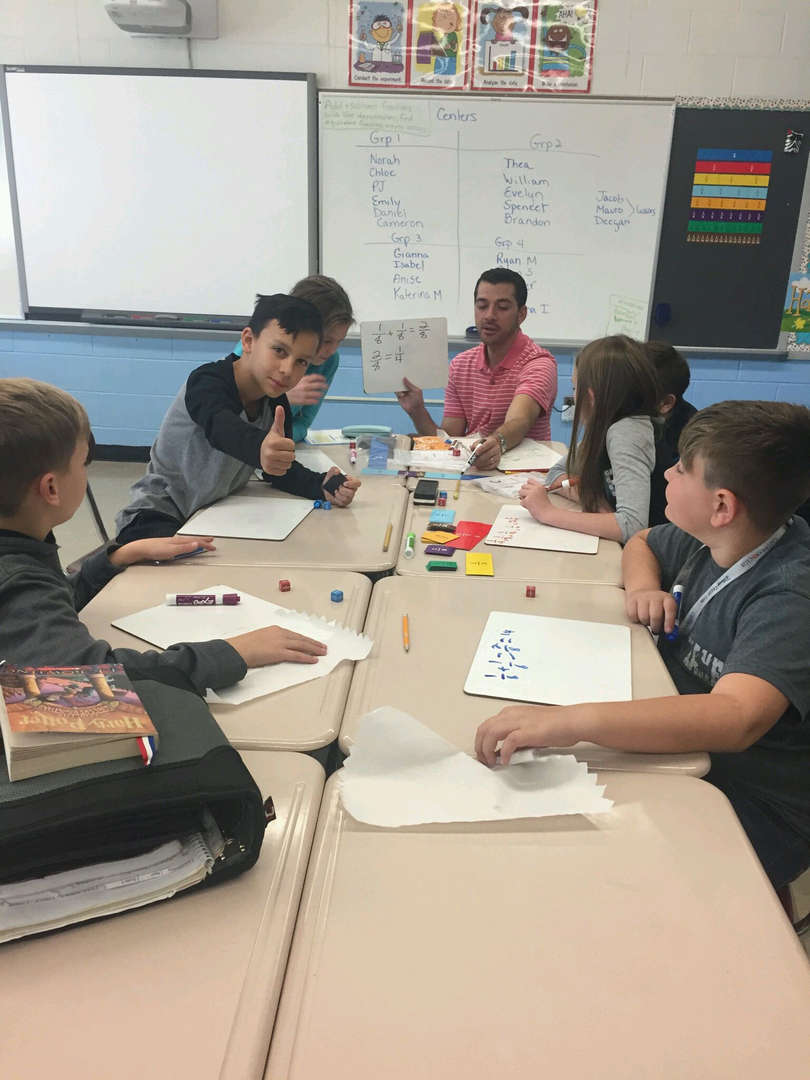 a group of students working on math work sheets