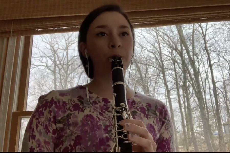 Student musician playing clarinet