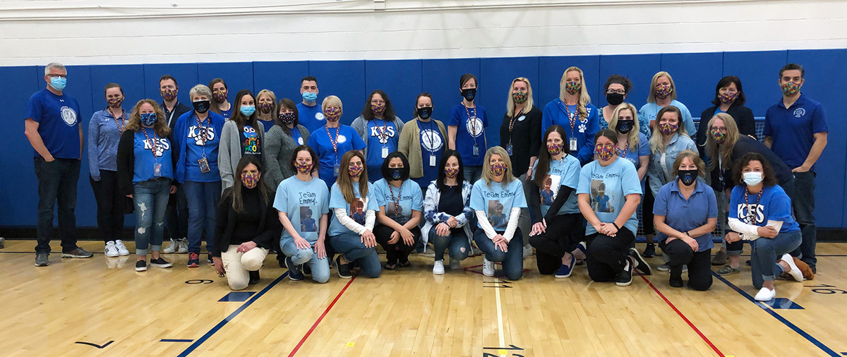 Large group of employees wear blue for Autism awareness