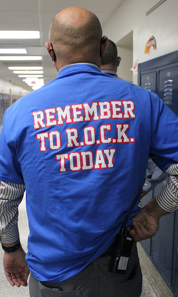 Back of a blue shirt that says: Remember to R.O.C.K. today