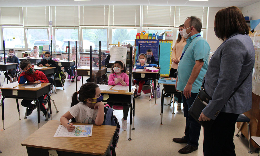 CCSD staff welcome students in classroom