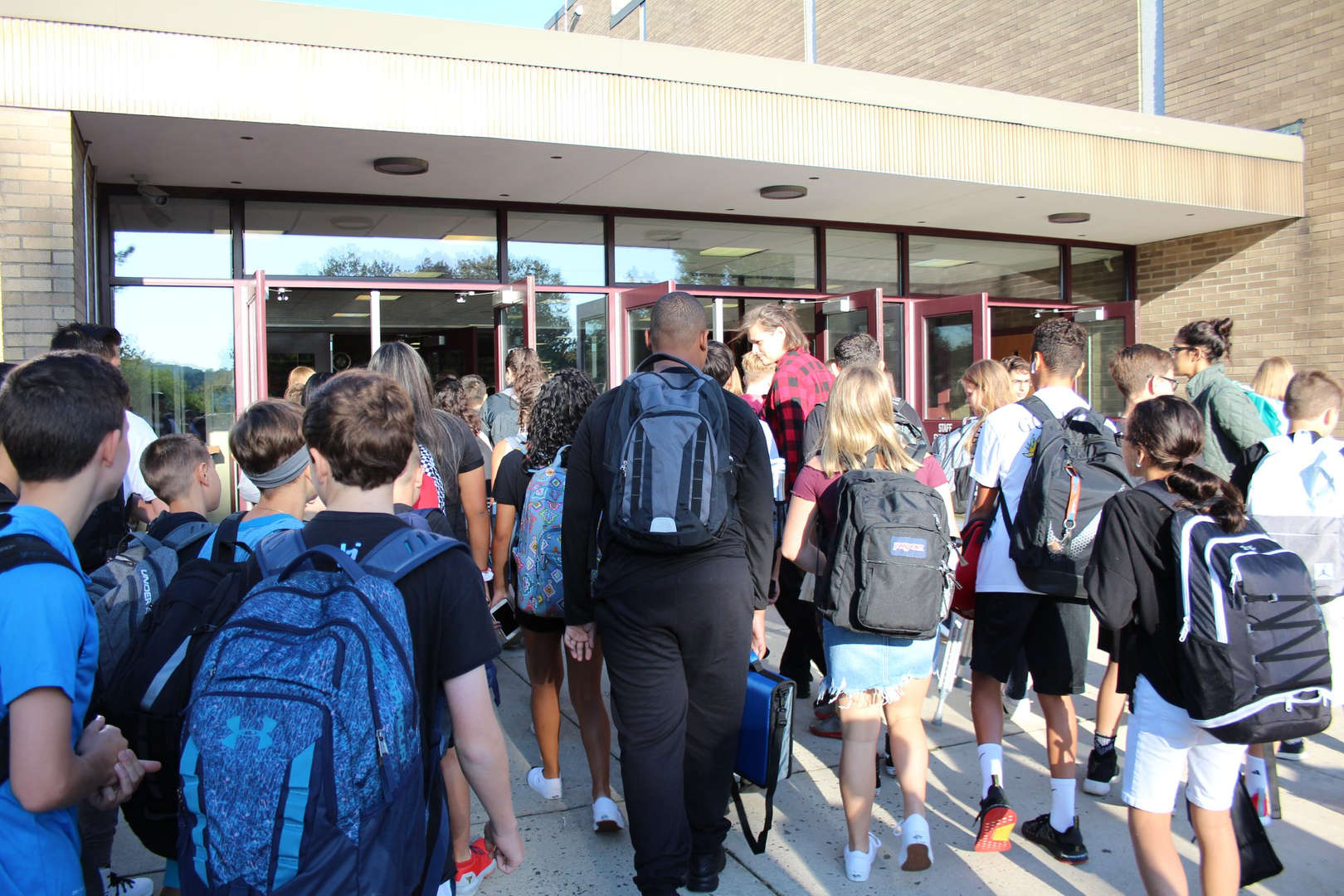 Students entering the school building on the first day of school