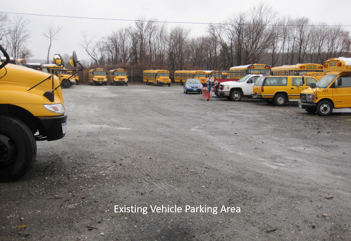 Many buses are parked on gravel because DEP/DEC wetland regulations prohibit the District from blacktopping the area.