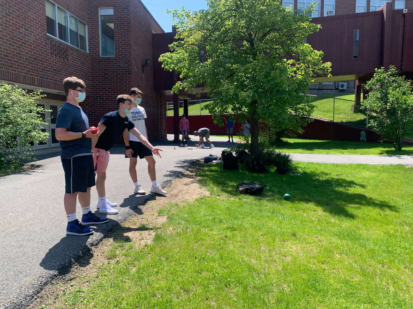 Students playing lawn games outside