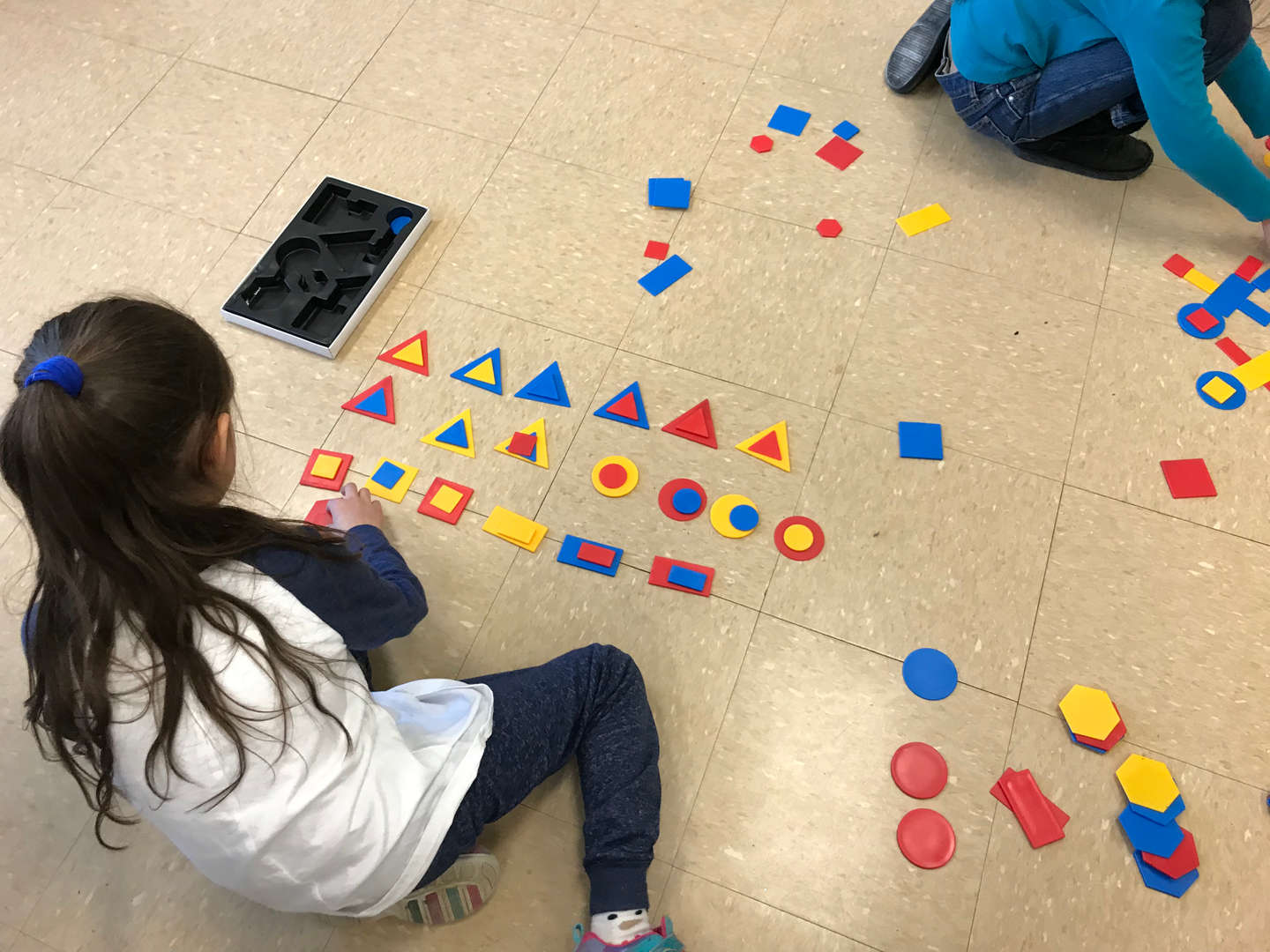 student playing with math manipulatives