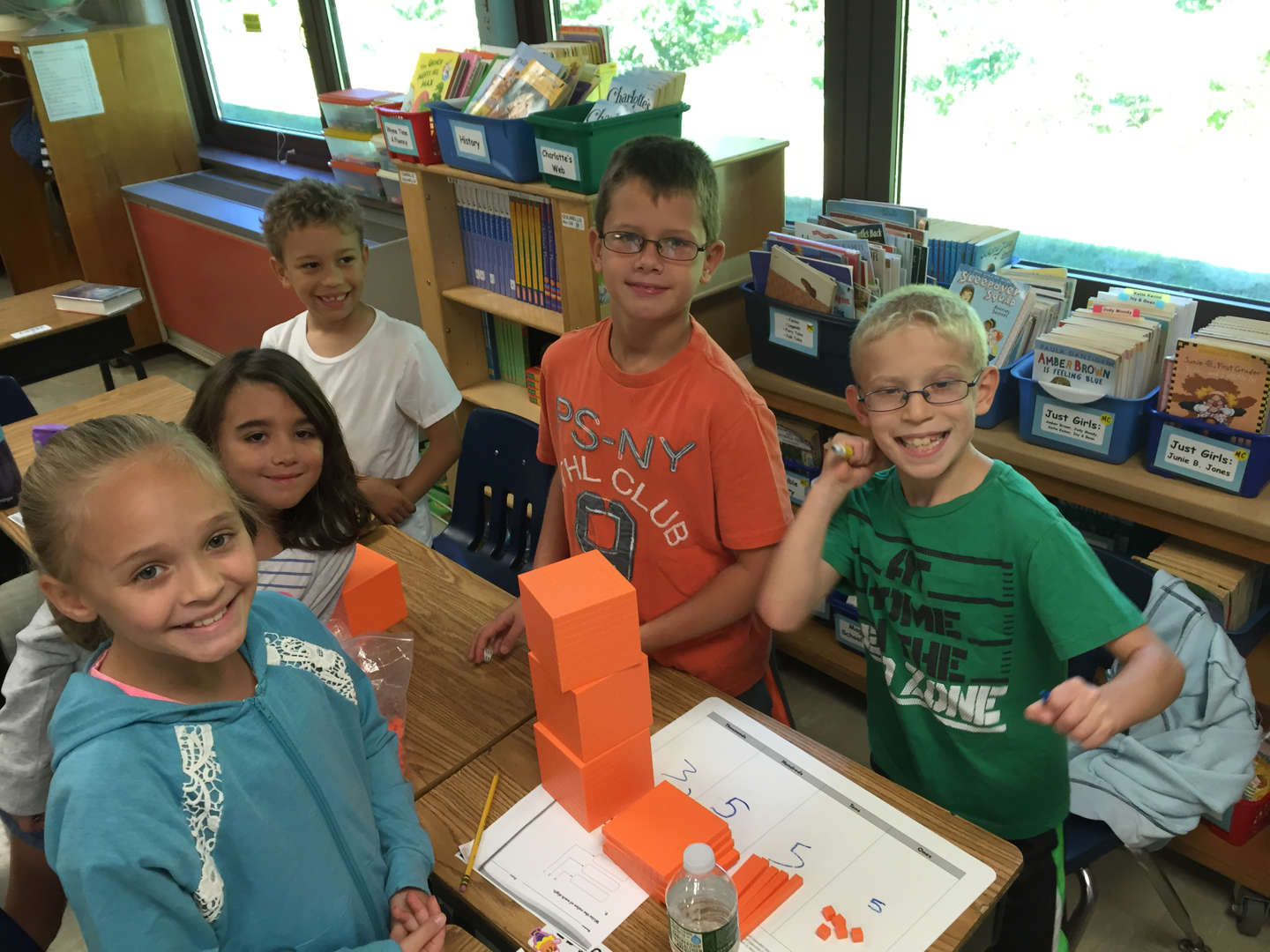 several students showing their math cubes