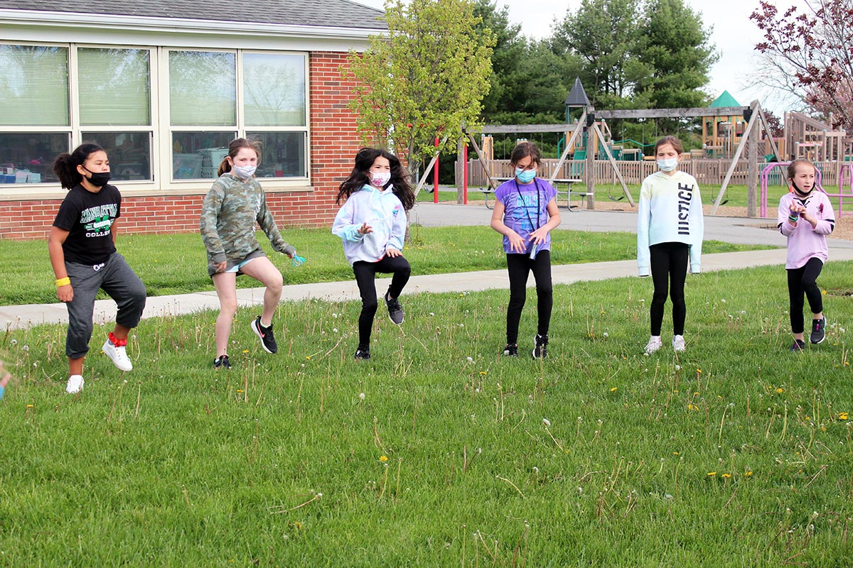 Students do warm up exercises before running.