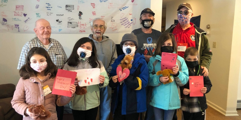 Students deliver cards to senior citizens