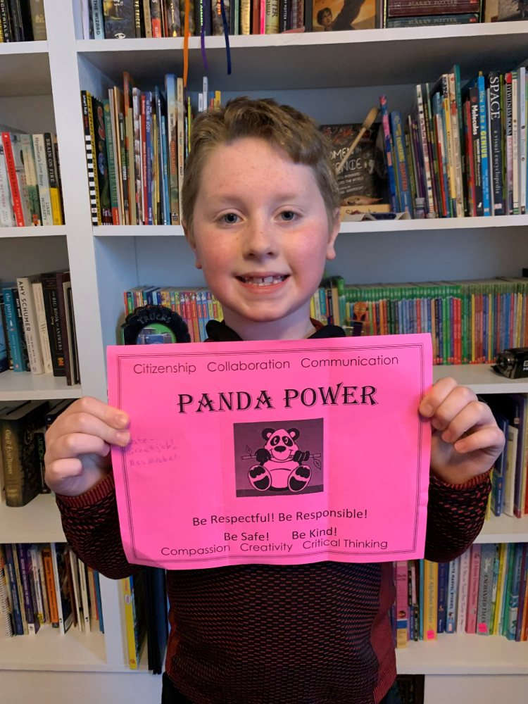 Student holds a pink Panda Power ticket