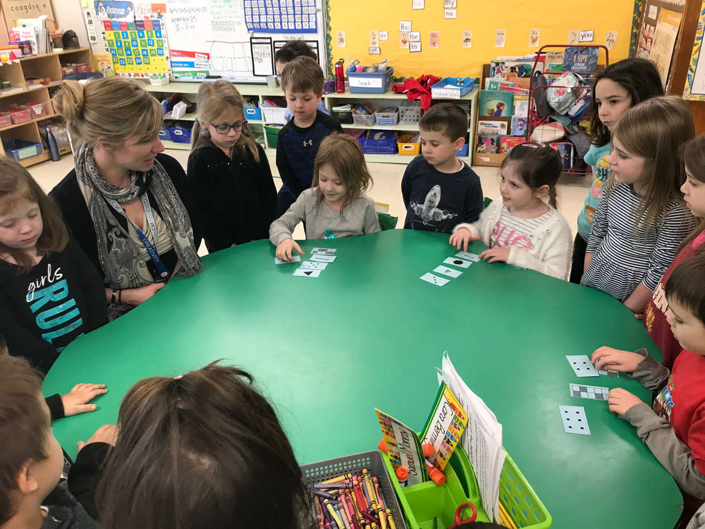 Students and teacher playing a math game
