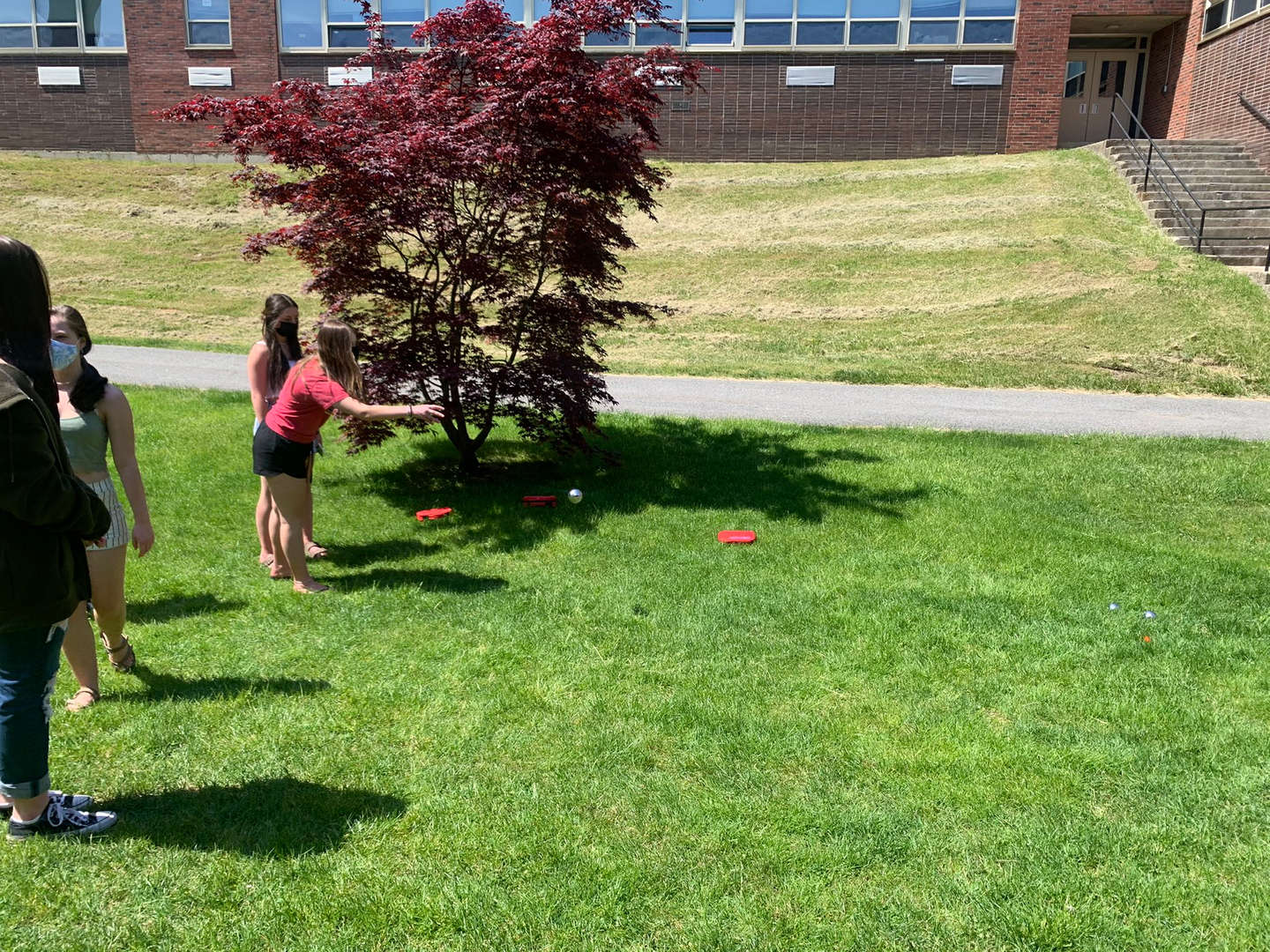 Students from the High School French Club, Italian Club and Spanish Club play games outdoors