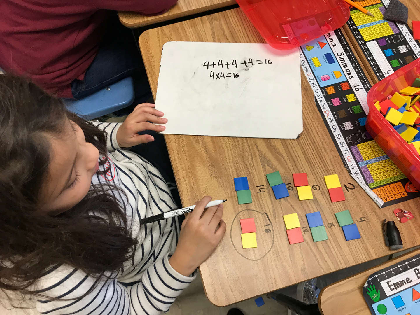 Student working with math tiles