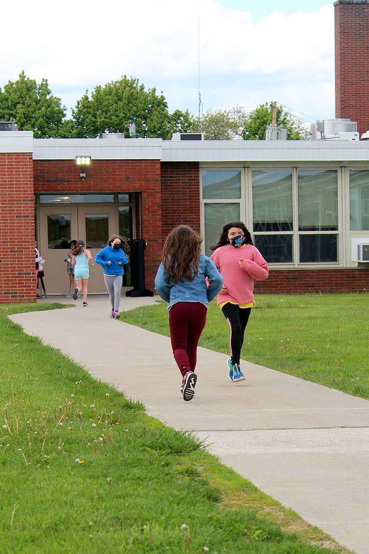 Students practice running outside Kent Elementary School.