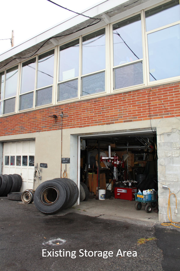 Bus tires are stored and worked on in a small space under Kent Elementary School.