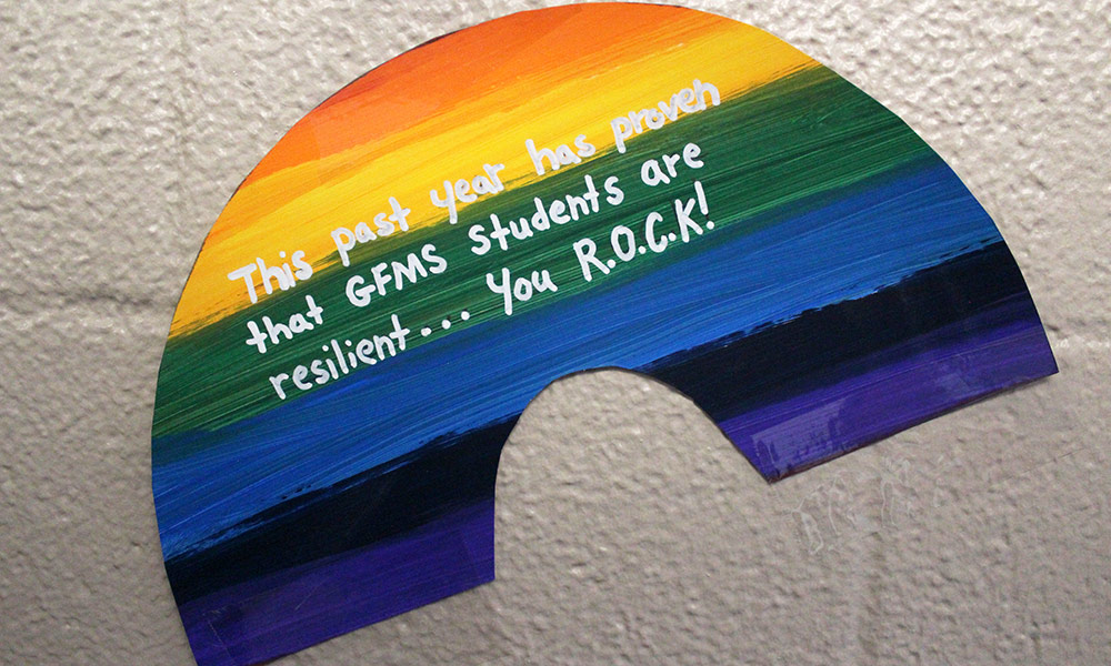 Rainbow sign on walls that says: This past year has proven that GFMS students are resilient... you R.O.C.K.!