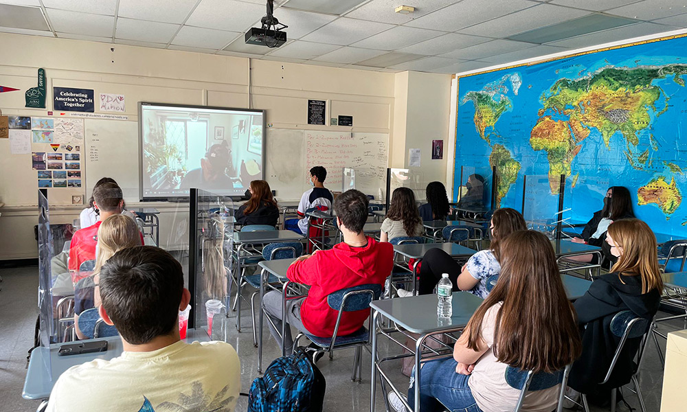 Students in class watch Alan Moskin presentation on screen