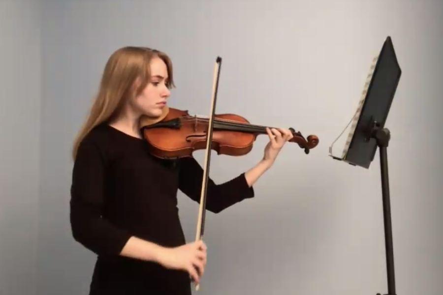 Student musician playing violin