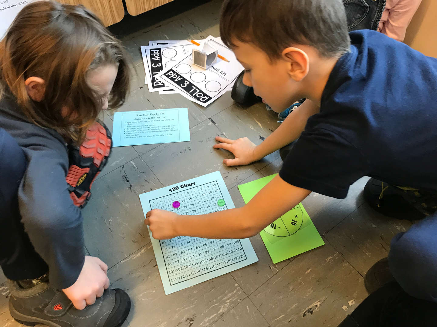 students solving math problems with manipulatives
