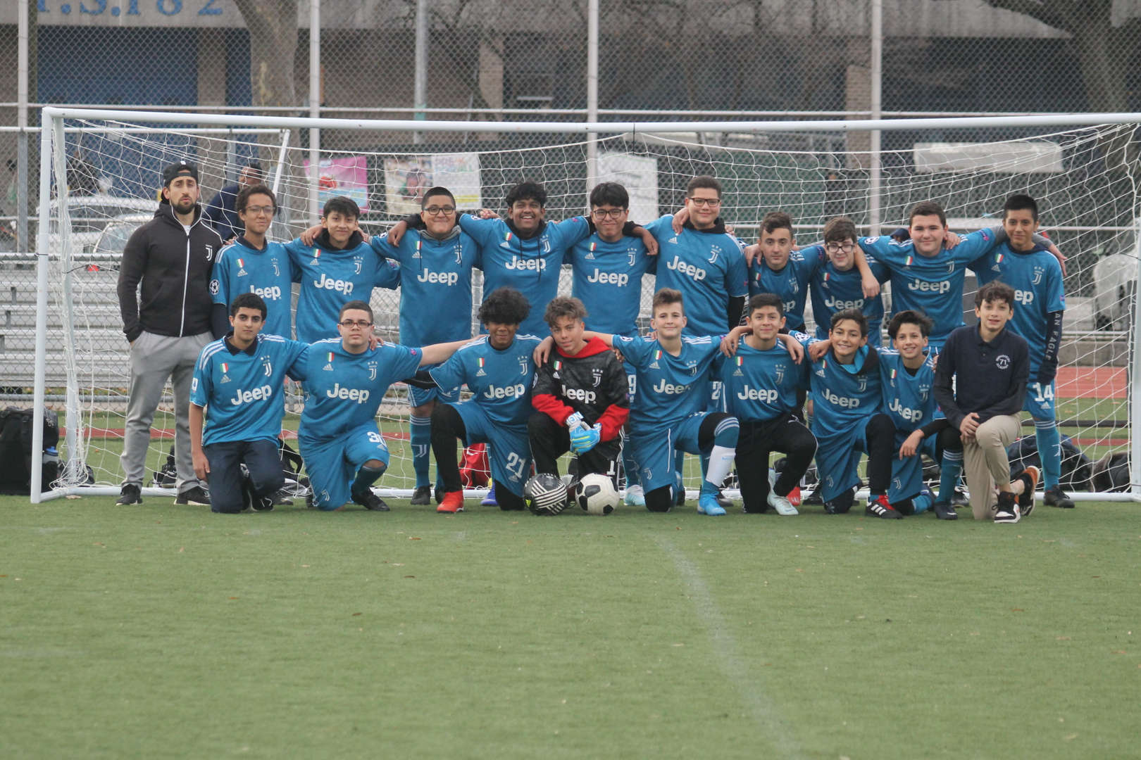 PS MS 71 Soccer team with Mr. Pellagrino pose in front of the goal.