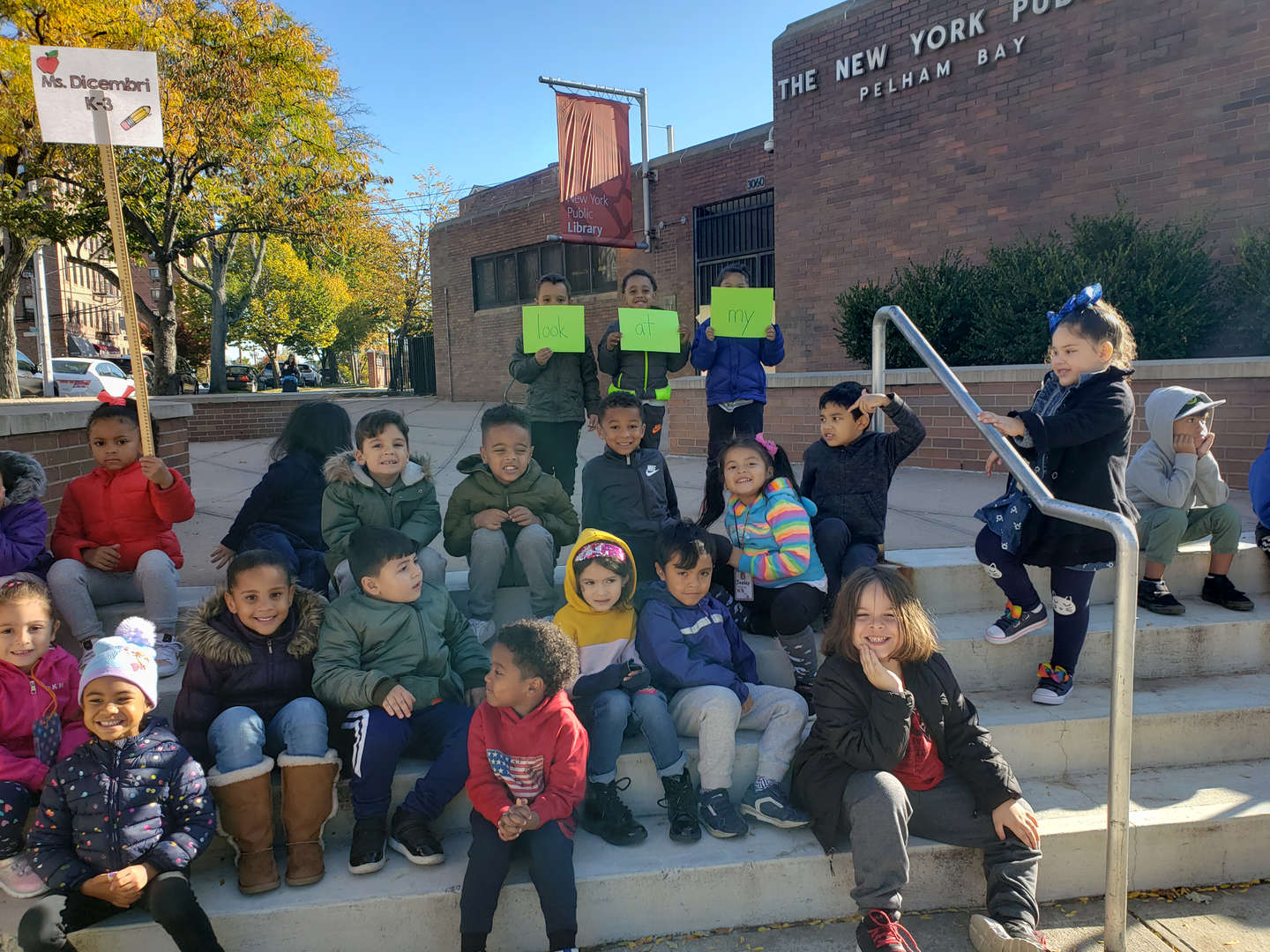 Kindergarten students partake in a community walk while using site words to describe what they see