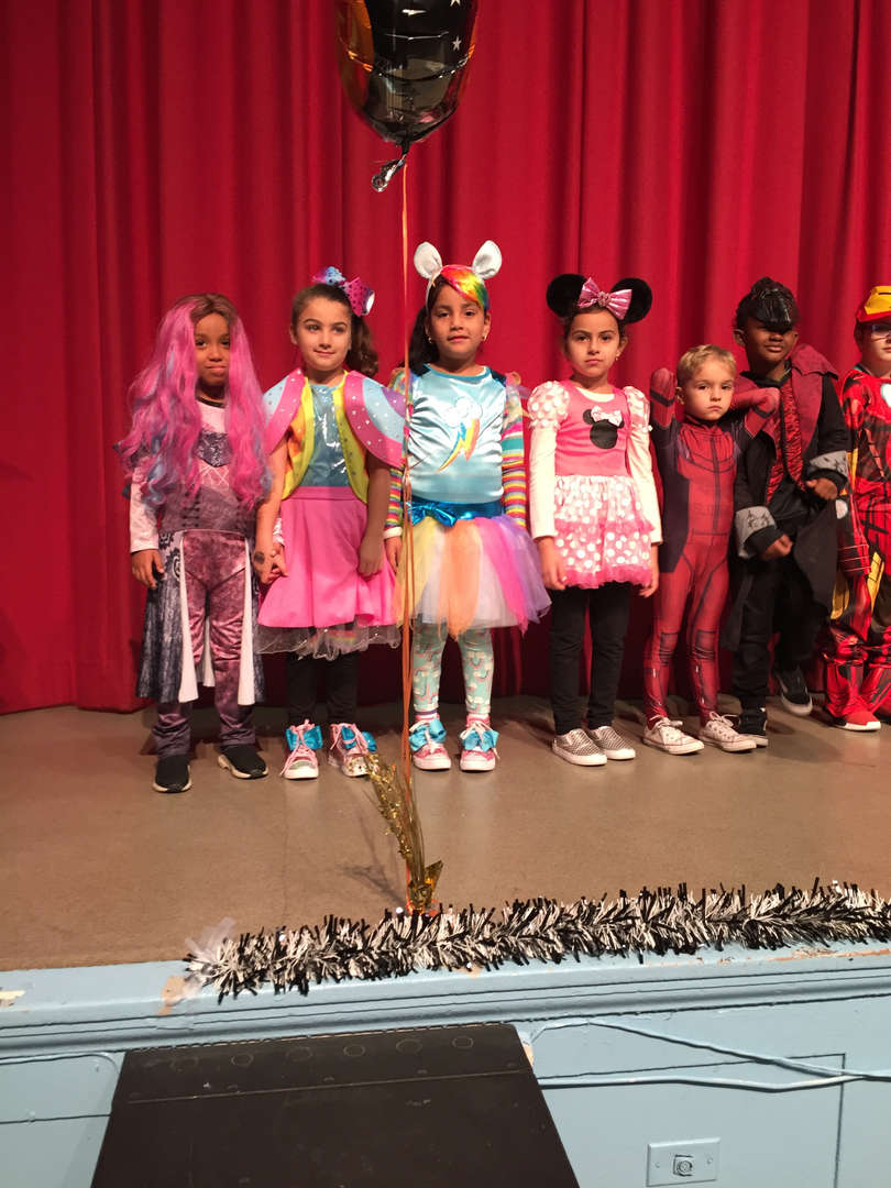 Children on parade in their halloween costumes